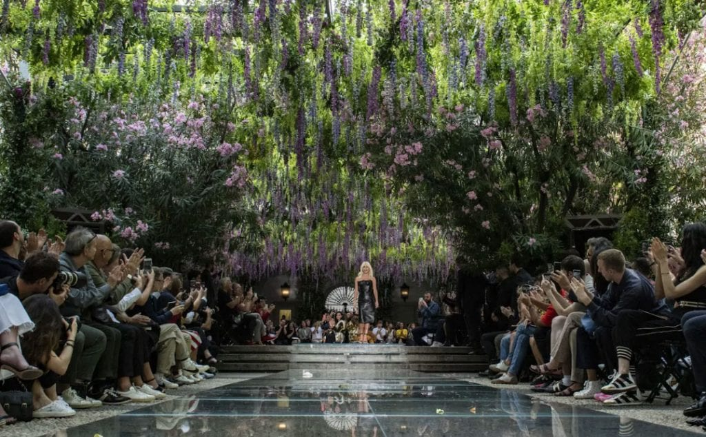Donatella Versace takes to the wisteria-covered catwalk following the show CREDIT: GETTY IMAGES EUROPE